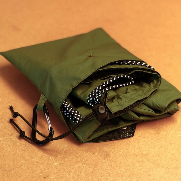 Carlisle Whip-it-Away Mac in Olive Green. Packs neatly away into its own carry bag.