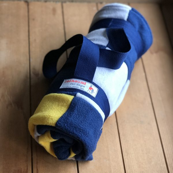 Patchwork fleece dog blanket, now with carry strap. Perfect to sling over your shoulder.